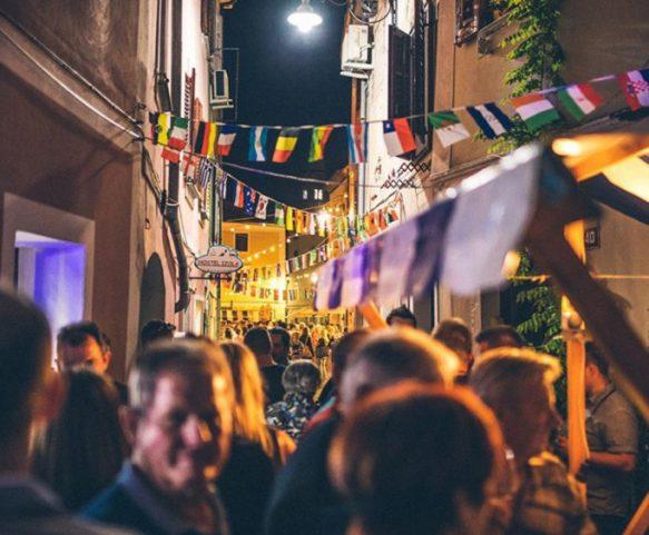 Busy street of Izola at night
